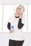 Beautiful sporty woman wiping her sweat after workout Royalty Free Stock Images