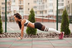 Beautiful sporty woman is working out royalty free stock photos