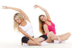 Sporty women do exercises. Fitness. Royalty Free Stock Image