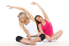 Sporty women do exercises. Fitness. Royalty Free Stock Photography