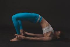Beautiful sporty yogi girl practices yoga asana Royalty Free Stock Image