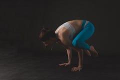 Beautiful sporty yogi girl practices yoga asana Stock Image