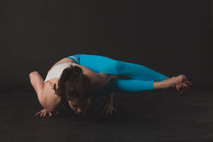 Beautiful sporty yogi girl practices yoga asana Royalty Free Stock Photo