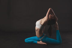 Beautiful sporty yogi girl practices yoga asana Stock Photos