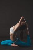 Beautiful sporty yogi girl practices yoga asana royalty free stock photos