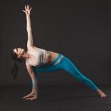 Beautiful sporty yogi girl practices yoga asana stock images
