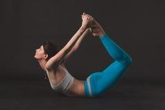 Beautiful sporty yogi girl practices yoga asana stock photo