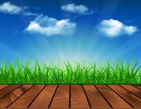 Beautiful  Spring background. Wooden deck in front of green grass. Beautiful spring background of blue sky. vector background summer design  green garden nature Stock Photography