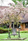 Bell of the United Church of Christ, Williams Bay, Wisconsin. A beautiful spring blooming tree in front of the United Church of Christ in Williams Bay, WI with a stock images