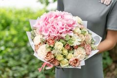 Beautiful spring bouquet. flower arrangement with hydrangea and peonies. Color light pink. The concept of a flower shop Stock Photos