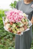Beautiful spring bouquet. flower arrangement with hydrangea and peonies. Color light pink. The concept of a flower shop Royalty Free Stock Image