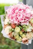 Beautiful spring bouquet. flower arrangement with hydrangea and peonies. Color light pink. The concept of a flower shop Royalty Free Stock Photos