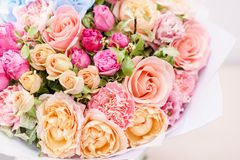 Free Beautiful Spring Bouquet. Flowers Arrangement With Various Of Colors In Glass Vase On Pink Table. Bright Room, White Stock Images - 129984624