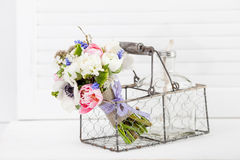 Beautiful spring bouquet in rustic style basket Royalty Free Stock Image