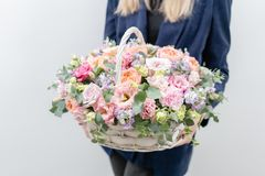 Beautiful spring bouquet in wicker basket. Arrangement with various flowers. The concept of a flower shop. A set of. Photos for a site or catalogue. Work stock photos