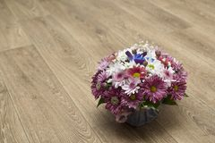 Beautiful spring bouquet of wild flowers in a box on a wooden background stock photos