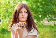 Beautiful spring brunette girl in a garden Stock Photography
