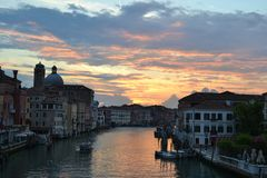 Beautiful spring cloudy purple sunset over the Grand Canal in Venice. stock photography