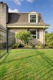 Beautiful spring fenced backyard with trim Stock Photo