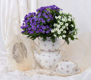 Beautiful spring flowers in a glass teapot Stock Photography