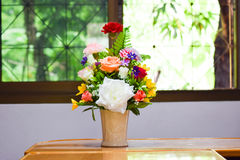 Beautiful spring flowers in a glass vase on meeting room,businees room Royalty Free Stock Images