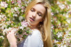 Beautiful spring girl in blooming tree Royalty Free Stock Photos
