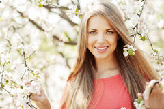 Beautiful spring girl in blooming tree royalty free stock images
