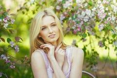 Beautiful spring girl in blooming tree Stock Photo