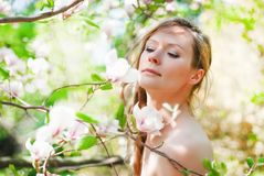 Beautiful Spring Girl with flowers. Beautiful Spring Girl with the magnolia flowers Stock Images