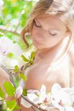 Beautiful Spring Girl with flowers. Beautiful Spring Girl with the magnolia flowers Royalty Free Stock Image