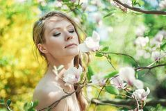 Beautiful Spring Girl with flowers Stock Photography
