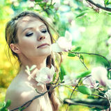 Beautiful Spring Girl with flowers Royalty Free Stock Photography