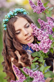 Beautiful spring girl in lilac flowers Royalty Free Stock Photos