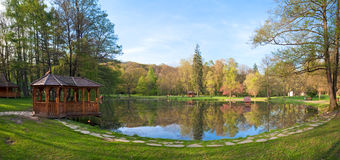 Beautiful spring lake in park. Stock Photos
