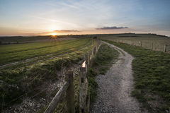 Beautiful Spring landscape of gate leading footpath into fields Stock Photography