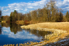 Beautiful spring landscape with reflection on the sunny day. Park of Pavlovsk. Saint Petersburg. Russia Royalty Free Stock Photo