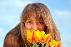 Beautiful spring portrait with tulips. Royalty Free Stock Photography