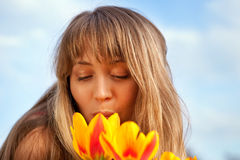 Beautiful spring portrait with tulips. Stock Photography