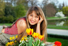 Beautiful spring portrait with tulips. Royalty Free Stock Images