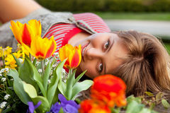 Beautiful spring portrait with tulips. Royalty Free Stock Photo
