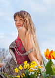 Beautiful spring portrait with tulips. Stock Images