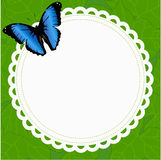 Beautiful spring round frame with a butterfly on a background of Stock Photography