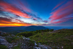 Beautiful spring sunrise in mountains Stock Photo