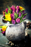 Beautiful spring tulips bouquet, easter eggs and garden tools Stock Images