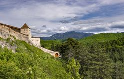 Beautiful spring view of the entrance in the Rasnov citadel in Brasov county Romania, with Postavaru mountains in the background stock photography
