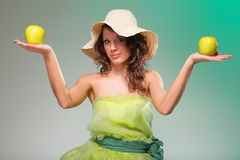 Beautiful spring woman with apple. Green concept Stock Photos