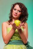 Beautiful spring woman with apple. Green concept Stock Image