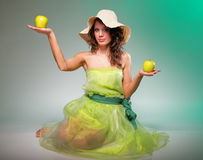 Beautiful spring woman with apple. Green concept Royalty Free Stock Photo