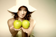 Beautiful spring woman with apples. Green concept Royalty Free Stock Photos