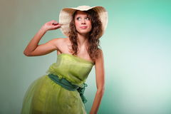 Beautiful spring woman portrait. Green concept. Beautiful smiling spring or summer woman in hat. Green concept Stock Image